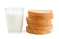 Glass of milk and sliced bread Stock Photos