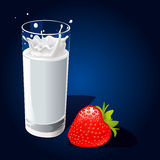 Glass of milk with splash and strawberry Royalty Free Stock Photography
