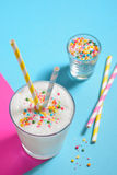 Glass of milk and Sprinkles Royalty Free Stock Image