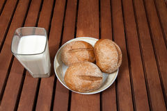 Glass of milk standing on old wooden table Royalty Free Stock Images