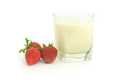 Glass of milk and strawberries Royalty Free Stock Photos