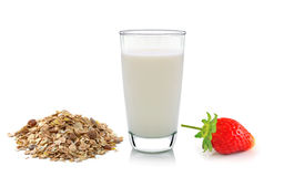 Glass of milk ,strawberry and muesli on white background Royalty Free Stock Photos