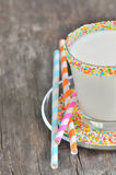 Glass of milk with striped straws Royalty Free Stock Photo