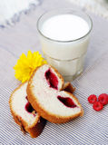 A glass of milk, sweat bake on tablecloth. A glass of milk, sweat bake and summer flower on tablecloth Royalty Free Stock Photography