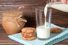 Glass of milk and tasty cookies Stock Photos