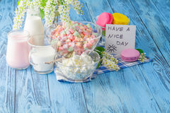 Glass of milk with Tasty macaroon on with background Royalty Free Stock Photo
