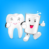 Glass of milk and tooth character, friends forever. Milk is good for teeth. Dental care concept, illustration on blue background Royalty Free Stock Photography