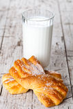 Glass of milk and two fresh baked buns Royalty Free Stock Photo