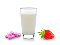 Glass of milk vitamin c and strawberry on white background Stock Photos