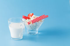 Glass of milk and wafer cookies on blue Royalty Free Stock Photos
