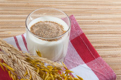 Glass of milk and wheat ears Stock Image