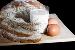 Glass of milk, wheat, eggs and bread Stock Images