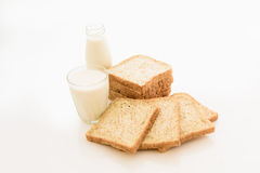 Glass of milk and whole wheat bread Royalty Free Stock Image