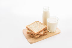 Glass of milk and whole wheat bread Stock Photography