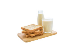 Glass of milk and whole wheat bread Royalty Free Stock Photography