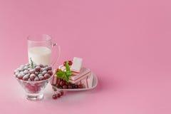 Glass of milk and wild cherry with sugar powder Stock Photo