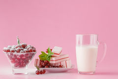 Glass of milk and wild cherry with sugar powder Royalty Free Stock Image