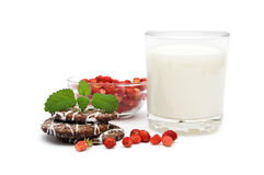 Glass of milk with wild strawberries and cookies. Isolated on a white background Royalty Free Stock Photos