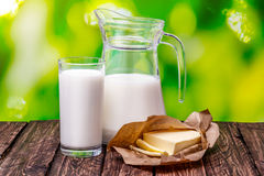 Glass of milk on a wooden table Nature Blur Stock Images