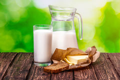 Glass of milk on a wooden table Nature Blur Stock Image