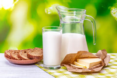 Glass of milk on a wooden table Nature Blur Stock Photos