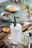 Glass with milkshake  and cookie . Stock Image