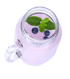 A glass of milkshake with mint. Blended blueberries in a mason jar isolated on a white background. Yogurt with berries. A view from above of a mason jar full of Royalty Free Stock Photo