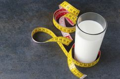 Concept of healthcare and healthy food.Tape measure and fresh milky product royalty free stock photo