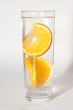 A glass of mineral water. With two slices of orange Stock Photography