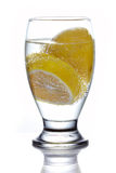 Glass of mineral water with sliced lemon Stock Image