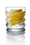 Glass of mineral water with sliced lemon Royalty Free Stock Images