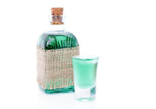 Glass of mint drink and bottle Royalty Free Stock Photography