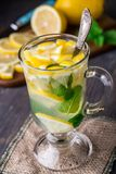 Glass with mint and lemon tea Royalty Free Stock Photo