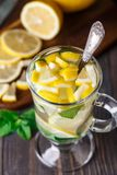 Glass with mint and lemon tea Royalty Free Stock Photography