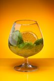Glass with mint and orange drink royalty free stock photos