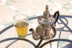 Glass of mint tea and teapot  Stock Image