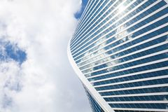 Free Glass Mirror Skyscraper Wall Spiral Shape On Blue Sky, White Clouds Background, Modern Business Center Building Stock Image - 151054901