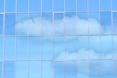 Glass mirror window. Reflexion of clouds in the big wall of the house from mirror glass stock photos