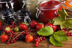 Glass of mixed berry jam with strawberries, bilberries, red curr Stock Photo