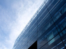 Glass modern architecture against blue sky Royalty Free Stock Images