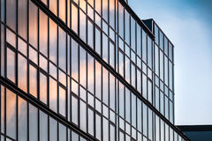 Glass Modern Building. Reflecting the Golden Cloud and Blue Sky in Twilight Stock Image