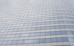 Glass modern business office building with cloud and sky reflecting,selective focus. Stock Image