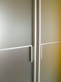 Glass modern door. A modern door with glass and aluminium Royalty Free Stock Images