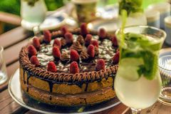 Glass of mojito and a cake Royalty Free Stock Photography