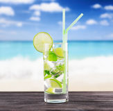 Glass of mojito cocktail on a beach Stock Photo