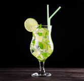 Glass of mojito cocktail on black background Stock Images