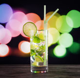 Glass of mojito cocktail on black table Royalty Free Stock Image