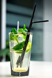 Glass of mojito cocktail in cafe interior Stock Photography