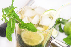 Glass of mojito cocktail, drink making tools, lime and mint. Royalty Free Stock Photo