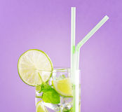 Glass of mojito cocktail on pastel pink background royalty free stock photo
